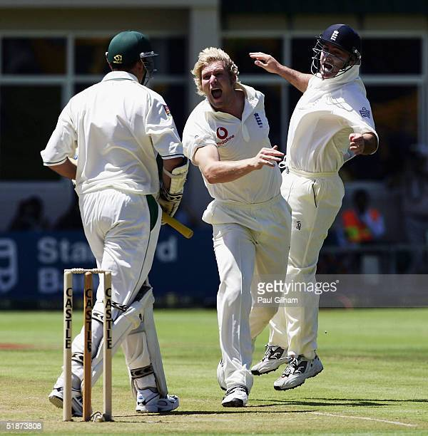 Matthew Hoggard of England celebrates with Graham Thorpe after taking the wicket of Graeme Smith of South Africa for no runs during day one of the...