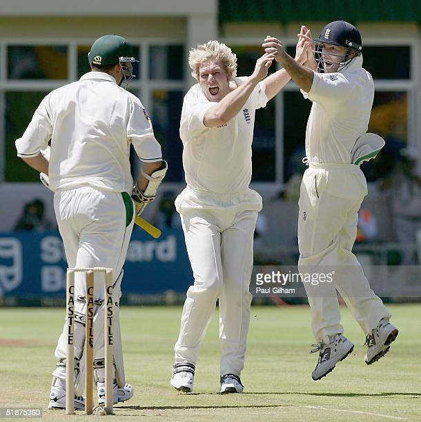 Matthew Hoggard of England celebrates with Graham Thorpe after taking the wicket of Graeme Smith of South Africa, for no runs, during day one of the...
