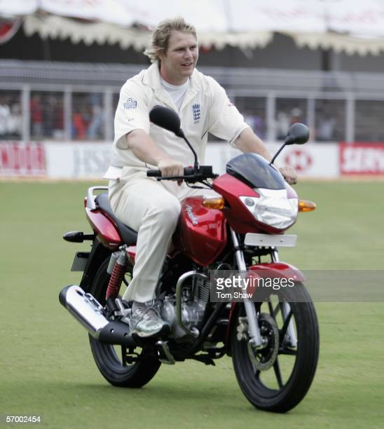 Matthew Hoggard of England drives his Man of the Match motorbike around the ground during day five of the First Test between India and England at the...