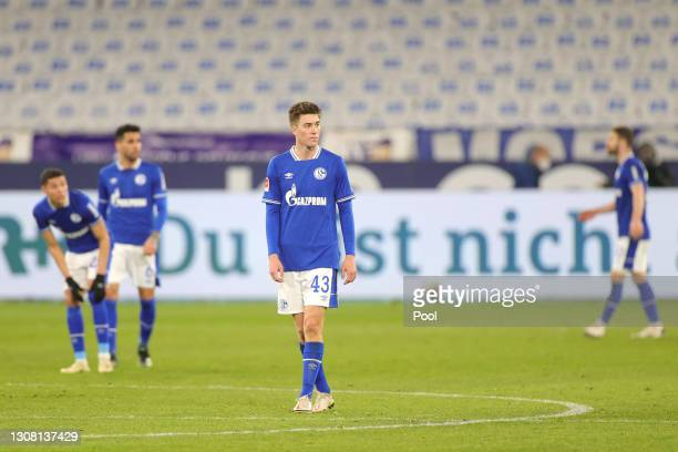 Matthew Hoppe of FC Schalke 04 reacts after conceding during the Bundesliga match between FC Schalke 04 and Borussia Moenchengladbach at...