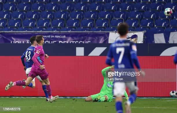 Matthew Hoppe of FC Schalke 04 scores their team's first goal past Oliver Baumann of TSG 1899 Hoffenheim during the Bundesliga match between FC...