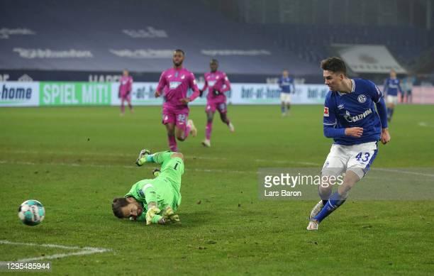 Matthew Hoppe of FC Schalke 04 scores their team's second goal past Oliver Baumann of TSG 1899 Hoffenheim during the Bundesliga match between FC...
