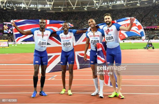 Matthew HudsonSmith Dwayne Cowan Rabah Yousif and Martyn Rooney of Great Britain celebrate after winning bronze in the Men's 4x400 Metres Relay final...