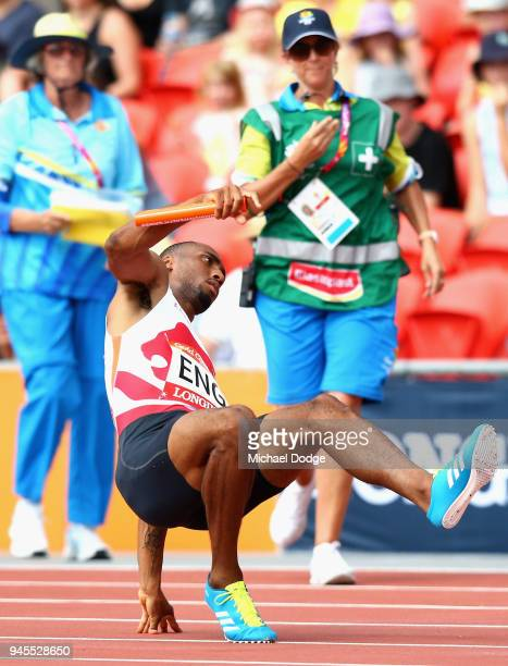 Matthew HudsonSmith of England reacts as he pulls up with an injury in the Men's 4x400 metres relay heats during athletic on day nine of the Gold...
