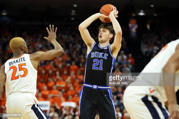 Matthew Hurt of the Duke Blue Devils shoots over Mamadi Diakite of the Virginia Cavaliers in the first half during a game at John Paul Jones Arena on...