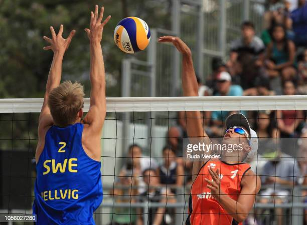 Matthew Immers of Netherlands spikes as he is blocked by Jonatan Hellvig of Sweden in Men's Gold Medal Match during day 11 of Buenos Aires 2018 Youth...