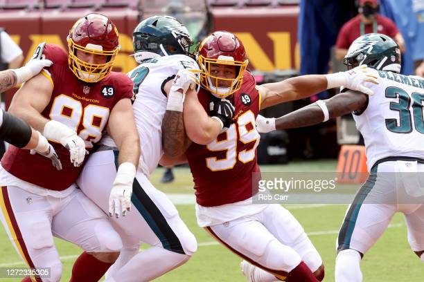 Matthew Ioannidis and Chase Young of the Washington Football Team rush the Philadelphia Eagles offense at FedExField on September 13, 2020 in...