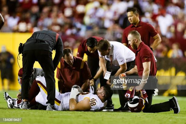 Matthew Ioannidis of the Washington Football Team is tended to by medical staff during the first quarter against the New York Giants at FedExField on...