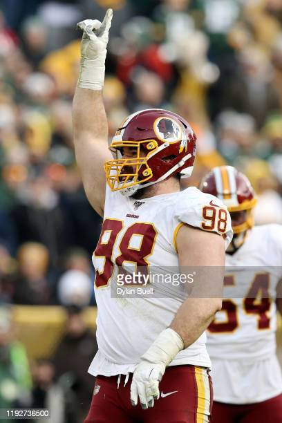 Matthew Ioannidis of the Washington Redskins celebrates after making a sack in the fourth quarter against the Green Bay Packers at Lambeau Field on...