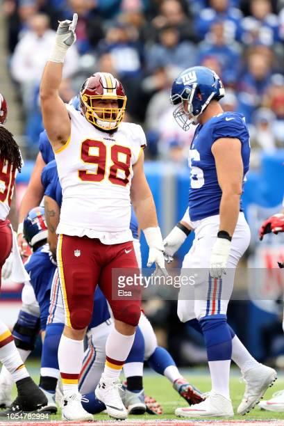 Matthew Ioannidis of the Washington Redskins celebrates after sacking Eli Manning of the New York Giants on October 28,2018 at MetLife Stadium in...