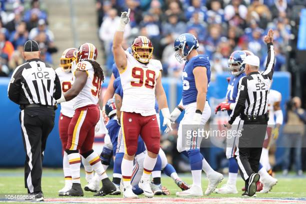 Matthew Ioannidis of the Washington Redskins reacts after a play against the New York Giants during the at MetLife Stadium on October 28, 2018 in...