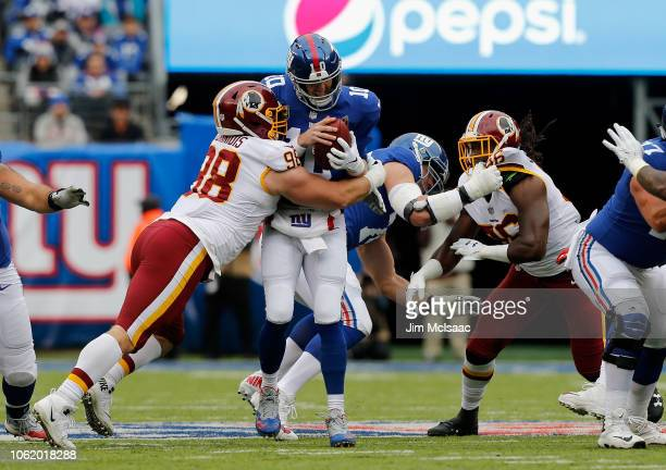 Matthew Ioannidis of the Washington Redskins sacks Eli Manning of the New York Giants on October 28, 2018 at MetLife Stadium in East Rutherford, New...