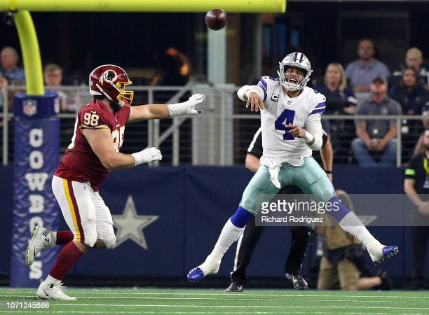 Matthew Ioannidis of the Washington Redskins tries to defend as Dak Prescott of the Dallas Cowboysfires a pass in a football game at AT&T Stadium on...