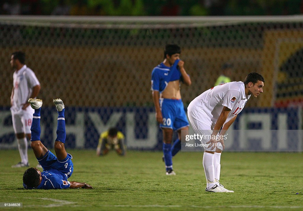 Matthew James of England (R) looks dejected along with the Uzbekistan players at the close of the FIFA U20 World Cup Group D match between Uzbekistan and England at the Mubarak Stadium on October 2, 2009 in Suez, Egypt.