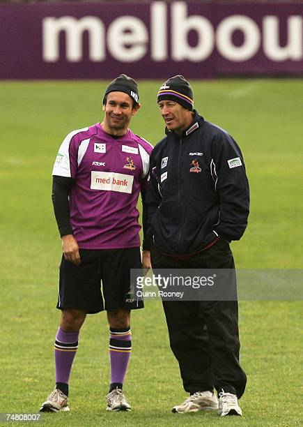 Matthew Johns and Craig Bellamy the coach of the Storm speak during a Melbourne Storm NRL training session held at MC Labour Park on June 20 2007 in...