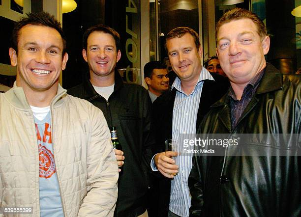 Matthew Johns Mark Waugh Andrew Voss and Phil Gould at the Temptation chocolates party on George Street in Sydney 31 May 2005 SHD NEWS Picture by...