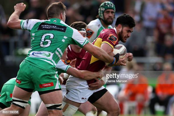 Matthew Johnson of Southland is tackled by Heiden Bedwell-Curtis of Manawatu during the round seven Mitre 10 Cup match between Southland and Manawatu...