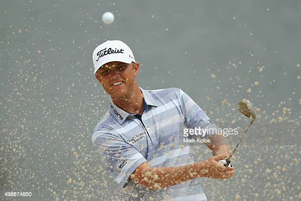 Matthew Jones of Australia plays a bunker shot on the 4th hole during day two of the Australian Open at the Australian Golf Club on November 27, 2015...