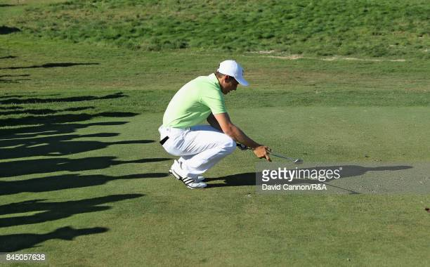 Matthew Jordan of England and the Great Britain and Ireland team sinks to his knees as his tee shot on the 15th hole just goes through the green in...