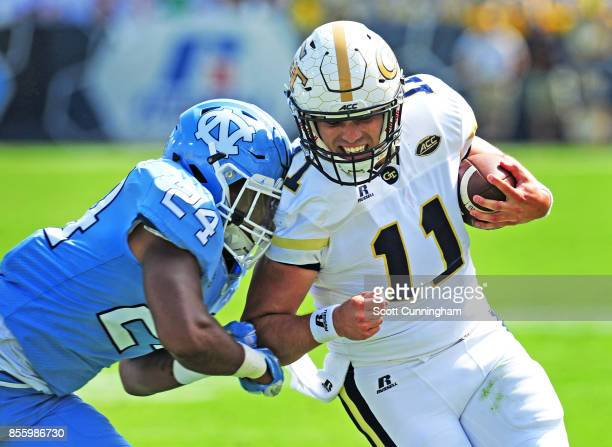 Matthew Jordan of the Georgia Tech Yellow Jackets carries the ball for a touchdown against Malik Robinson of the North Carolina Tar Heels on...