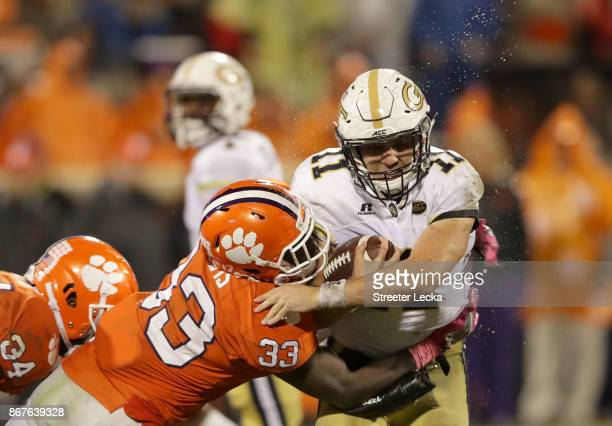 Matthew Jordan of the Georgia Tech Yellow Jackets is hit by JD Davis of the Clemson Tigers during their game at Memorial Stadium on October 28 2017...