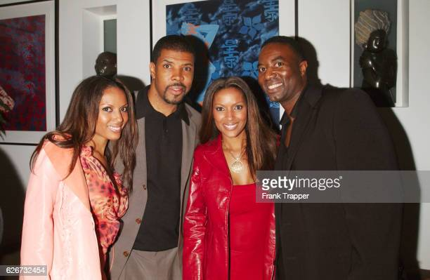 Matthew Jordan Smith and Eriq LaSalle with their Renee and Rosie Tenison at a launch party for photographer Smith's new book Sepia Dreams
