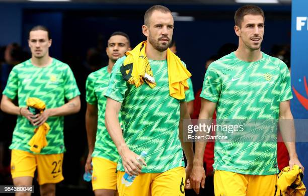 Matthew Jurman of Australia and Milos Degenek of Australia walk out prior to the 2018 FIFA World Cup Russia group C match between Australia and Peru...