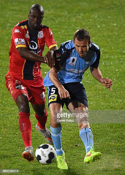 Matthew Jurman of Sydney competes for the ball against Bruce Djite of United during the FFA Cup Round of 16 match between Adelaide United and Sydney...