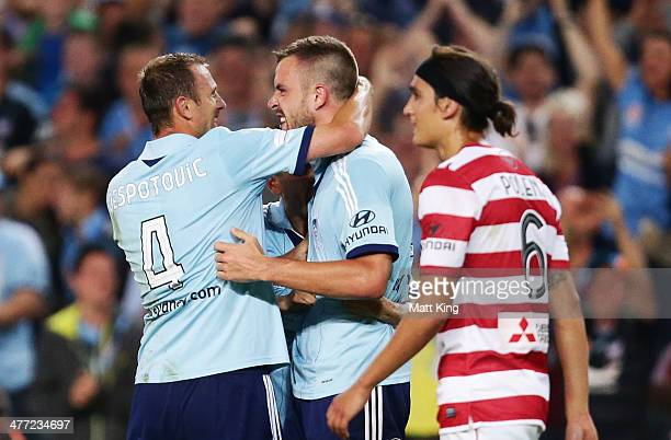 Matthew Jurman of Sydney FC celebrates with Ranko Despotovic after scoring a goal during the round 22 ALeague match between Sydney FC and the Western...