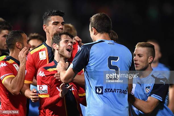 Matthew Jurman of Sydney reacts to Mate Dugandic of United during the FFA Cup Round of 16 match between Adelaide United and Sydney FC at Coopers...