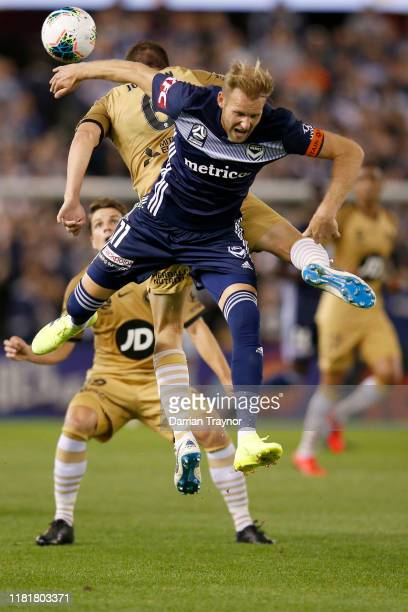 Matthew Jurman of the Wanderers and Ola Toivonen of the Victory compete for the ball during the round two A-League match between Melbourne Victory...