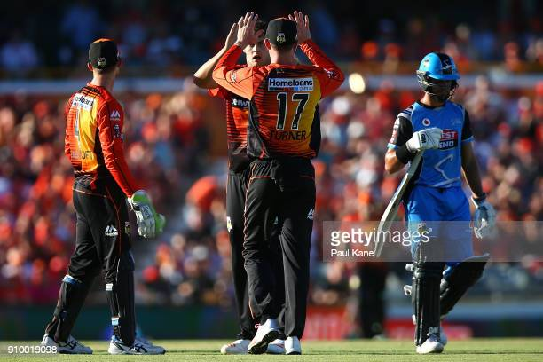 Matthew Kelly and Ashton Turner of the Scorchers celebrate the wicket of Jake Weatherald of the Strikers during the Big Bash League match between the...