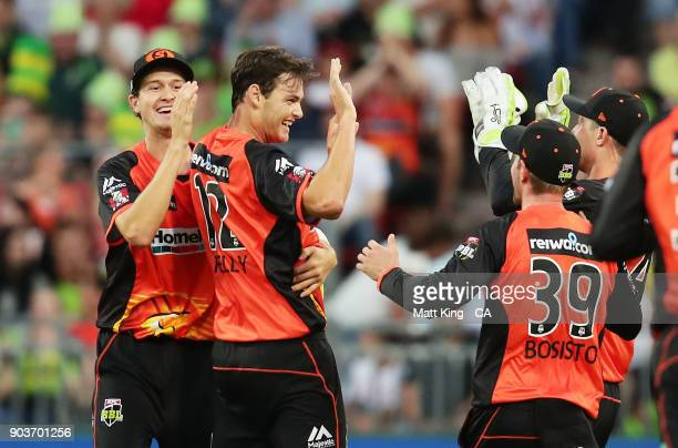 Matthew Kelly of the Scorchers celebrates with team mates after taking the wicket of Kurtis Patterson of the Thunder during the Big Bash League match...
