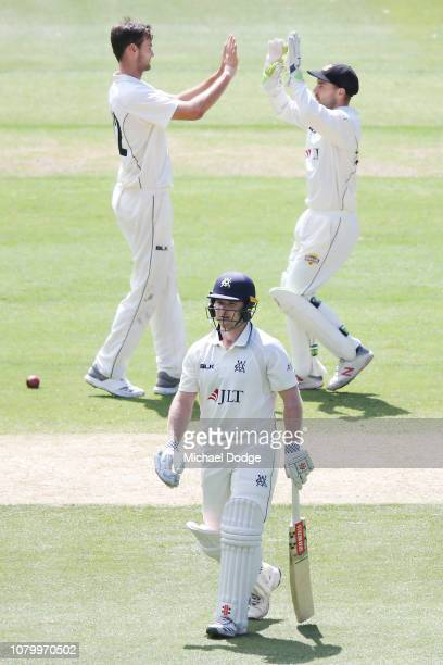 Matthew Kelly of Western Australia celebrates a wicket of Travis Dean of Victoria during day four of the Sheffield Shield match between Victoria and...