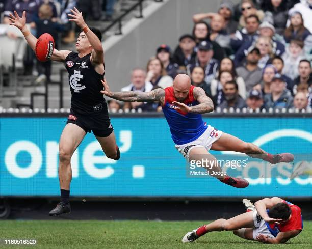 Matthew Kennedy of the Blues marks the ball against Nathan Jones of the Demons during the round 16 AFL match between the Carlton Blues and the...
