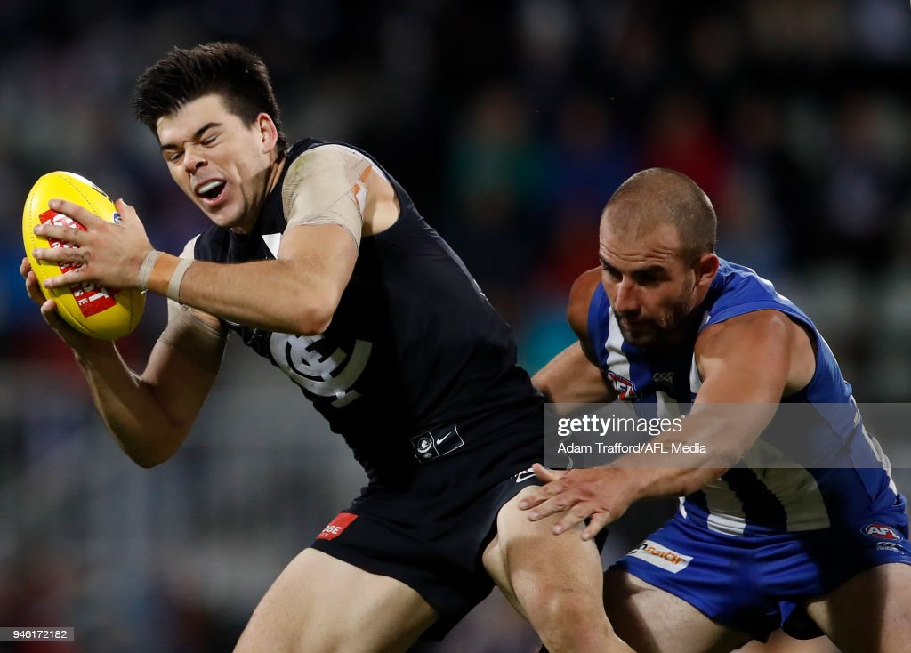 Matthew Kennedy of the Blues marks the ball ahead of Ben Cunnington of the Kangaroos during the 2018 AFL Round 04 match between the North Melbourne Kangaroos and the Carlton Blues at Blundstone Arena on April 14, 2018 in Hobart, Australia.