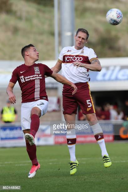 Matthew Kilgallon of Bradford City contests the ball with Billy Waters of Northampton Town during the Sky Bet League One match between Northampton...