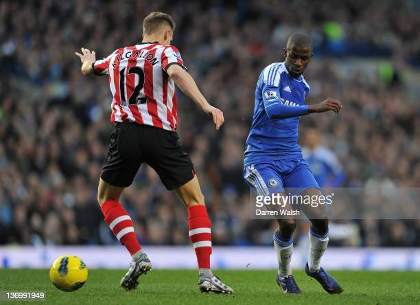 Matthew Kilgallon of Sunderland and Ramires of Chelsea battle for the ball during the Barclays Premier League match between Chelsea and Sunderland at...