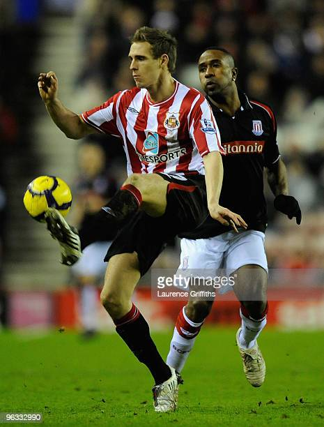 Matthew Kilgallon of Sunderland beats Ricardo Fuller of Stoke City to the ball during the Barclays Premier League match between Sunderland and Stoke...