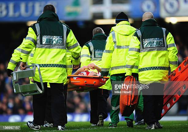 Matthew Kilgallon of Sunderland is stretchered off during the Barclays Premier League match between Chelsea and Sunderland at Stamford Bridge on...