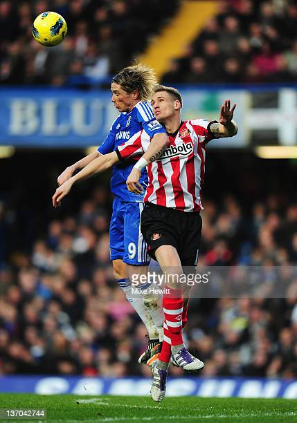 Matthew Kilgallon of Sunderland jumps with Fernando Torres of Chelsea during the Barclays Premier League match between Chelsea and Sunderland at...