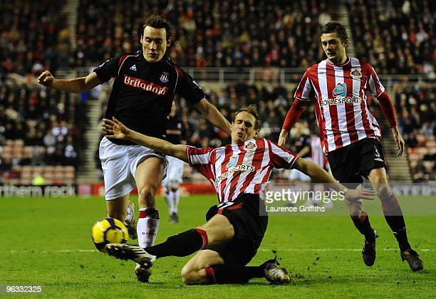 Matthew Kilgallon of Sunderland tackles Dean Whitehead of Stoke City during the Barclays Premier League match between Sunderland and Stoke City at...