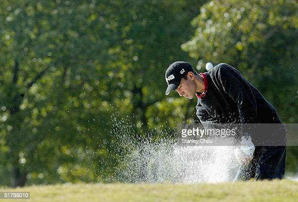Matthew King of England hits a bunker shot on the 9th hole during Round Three of the Volvo China Open held at the Silport Golf Club on November 27,...