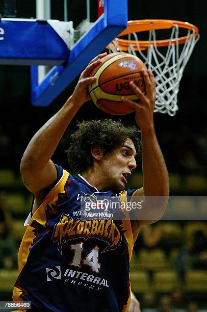 Matthew Knight of the Razorbacks rebounds during the round one NBL match between the West Sydney Razorbacks and the Townsville Crocodiles at the...