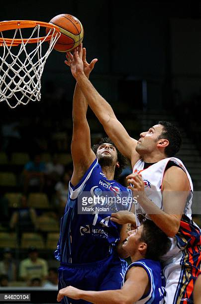 Matthew Knight of the Spirit and Matt Smith of the Taipans try to rebound during the round 21 NBL match between the Sydney Spirit and the Cairns...