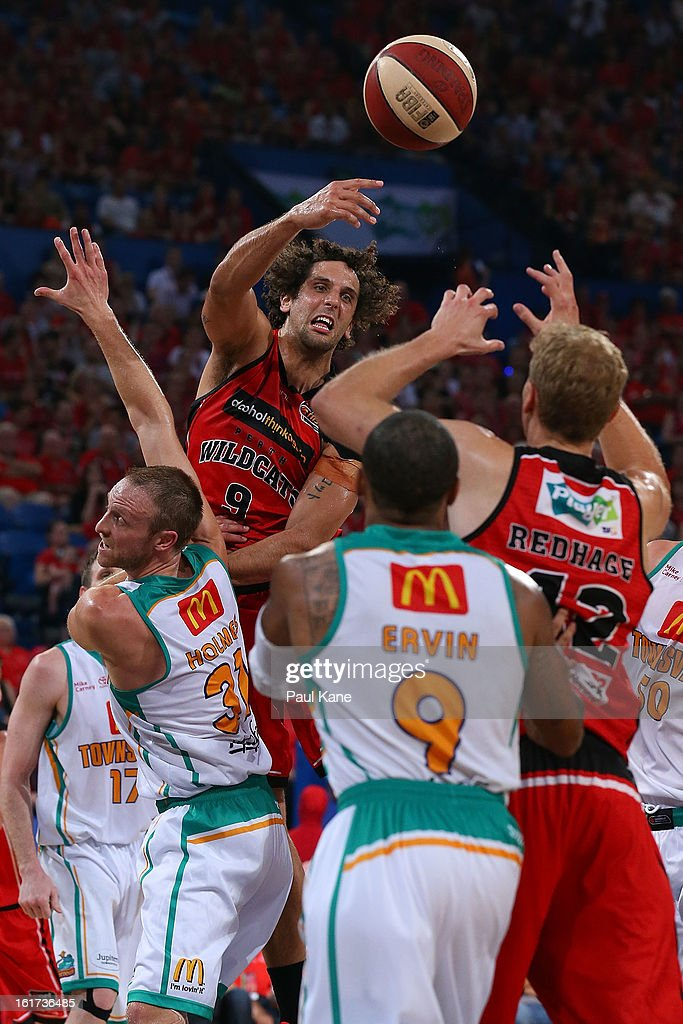 Matthew Knight of the Wildcats passes the ball during the round 19 NBL match between the Perth Wildcats and the Townsville Crocodiles at Perth Arena on February 15, 2013 in Perth, Australia.