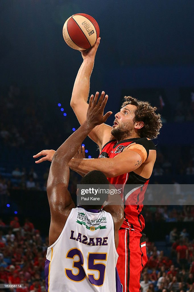 Matthew Knight of the Wildcats shoots against Darnell Lazare of the Kings during the round 22 NBL match between the Perth Wildcats and the Sydney Kings at Perth Arena on March 8, 2013 in Perth, Australia.