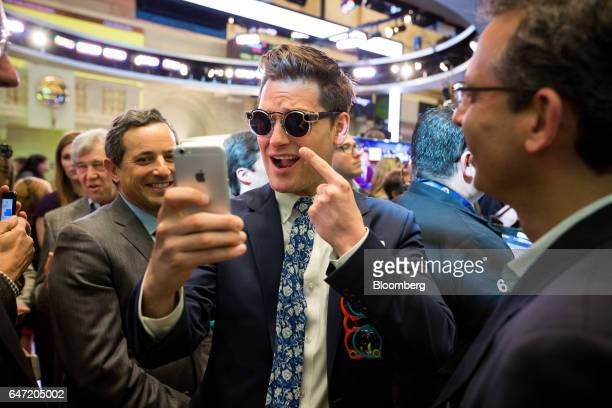 Matthew Kobach manager of digital and social media at the New York Stock Exchange center takes a selfie photograph wearing a pair of Snapchat...