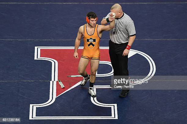 Matthew Kolodzik of the Princeton Tigers has his hand raised as the winner over AJ Vindici of the Pennsylvania Quakers at The Palestra on January 8...