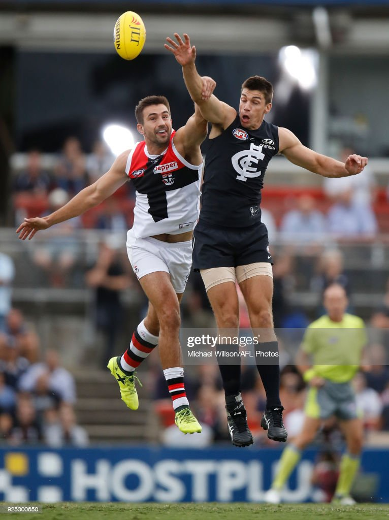 Matthew Kreuzer of the Blues and Billy Longer of the Saints compete for the ball during the AFL 2018 JLT Community Series match between the Carlton Blues and the St Kilda Saints at Ikon Park on February 28, 2018 in Melbourne, Australia.